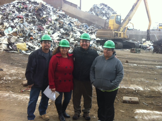 From left to right, Vicky Lugo is second and Pilsen Alliance executive director Nelson Soza is third.